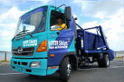 Skip Bin Hire truck ready and waiting for your rubbish removal