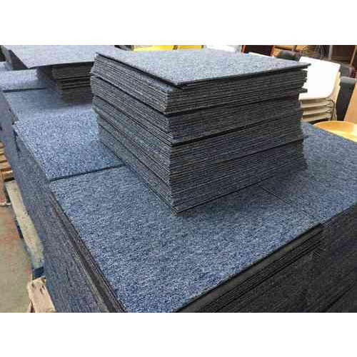 Stack of blue grey carpet tiles
