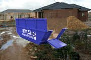 8.0m³ Skip Bins come in different shapes, this one has a cut-away end and a drop down ramp for easier loading