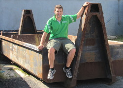 Nat sitting on one of our 8m skip bins